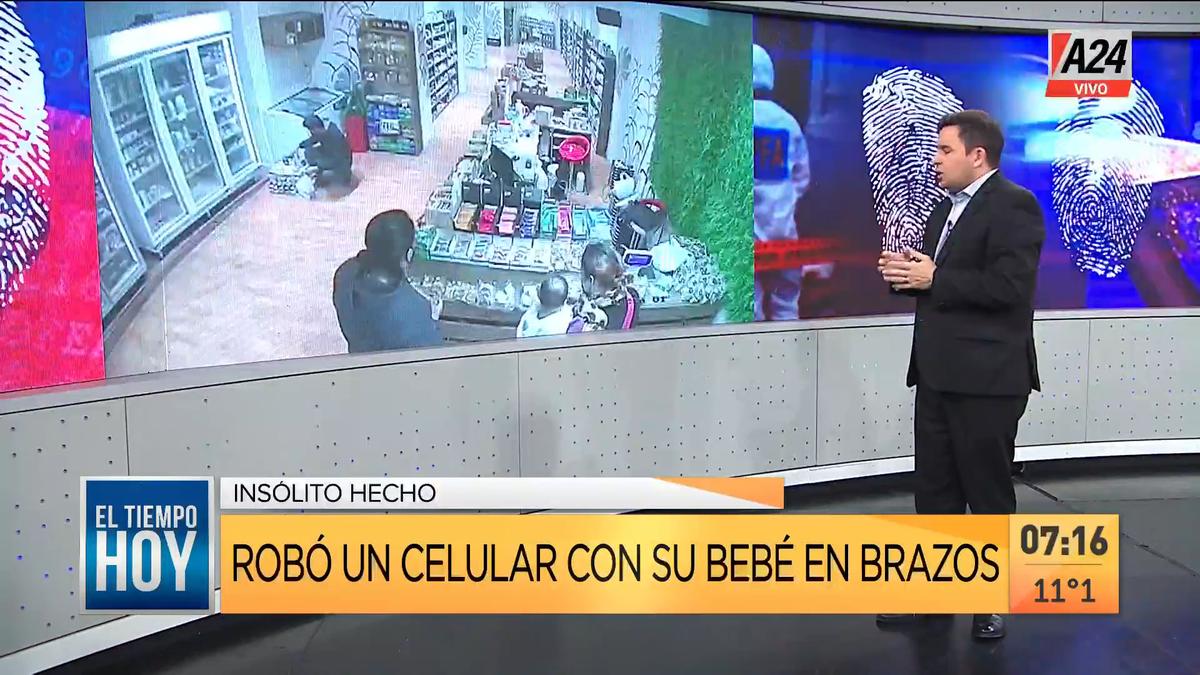 Así una mujer robó un celular con su bebé en brazos. (Captura de Tv)